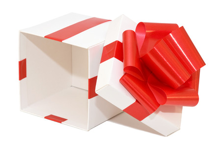 profit celebration: Gift box white with a red ribbon on a white background Stock Photo
