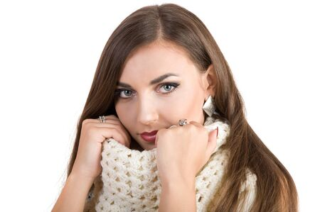 luxuriant: young beautiful girl in a white scarf. on a white background Stock Photo