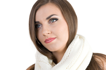 luxuriant: young beautiful girl in a white scarf on a white background