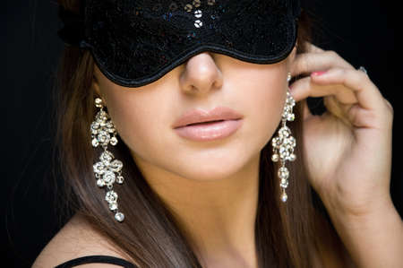 mysteries: beautiful sexy woman. her eyes closed mask. the effect of mystery Stock Photo