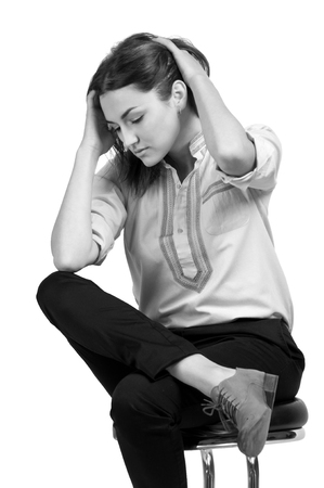 luxuriant: Business woman dressed in black trousers and brown shoes sits in a chair Stock Photo