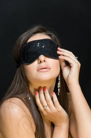 suspense: beautiful sexy woman. her eyes closed mask. the effect of mystery Stock Photo