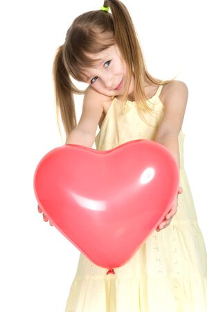 suddenness: little girl holding a gift. a balloon with a red heart