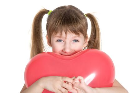 suddenness: little girl holding a balloon red heart-shaped