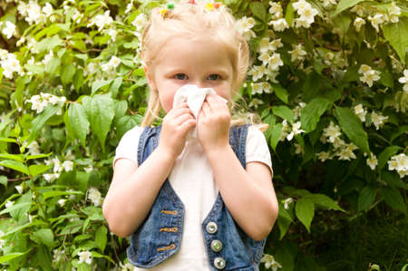 runny: girl has a runny nose. flowers pollen allergy Stock Photo