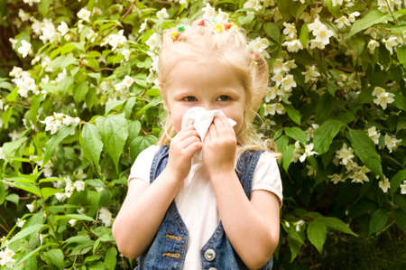 runny: The girl has a runny nose. flowers pollen allergy