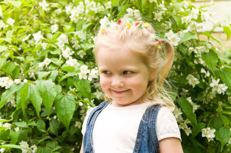 snot: little girl standing with white flowers