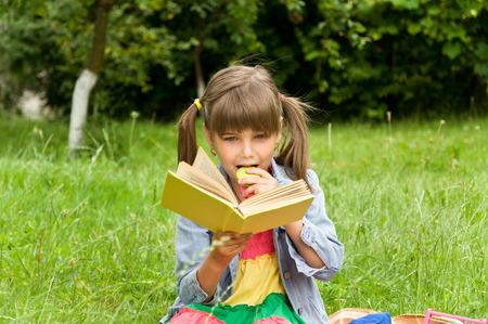 the pupil: smart little pupil reading books Stock Photo