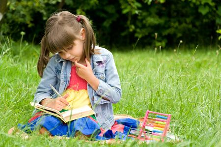 clever little pupil reading a book Stock Photo