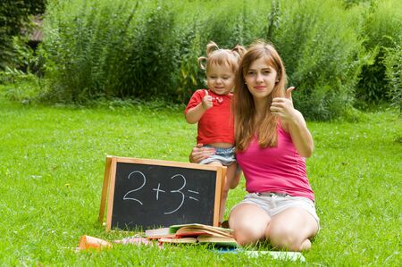 teaches: mother teaches daughter count. Early child development