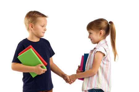 relationship between the children. boy and girl shaking hands with each other