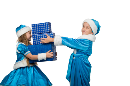 profit celebration: little children in costume holding boxes with gifts. New Year. Merry Christmas