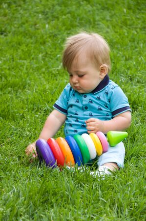 motility: little boy plays with a constructor in nature. early childhood development