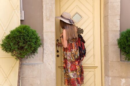 travel guide, tourism in Europe, woman opens the door Stock Photo
