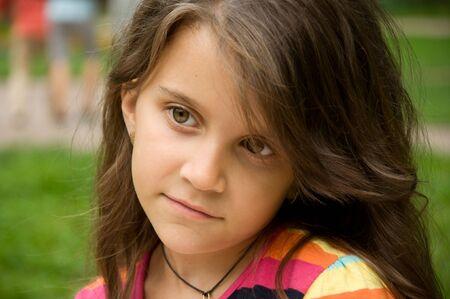 generosidad: Portrait of a child. Little girl having fun in the park Foto de archivo