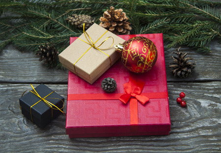 small different Christmas gift boxes on a rustic wooden background