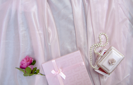 pink background with a box and pearl beads, tender love