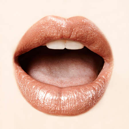 mouth close up: woman mouth close up beige with pink lipstick