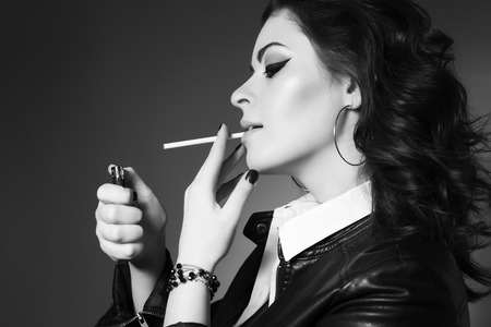 bad habit: Young beautiful woman smoking cigarette, addicted. Bad habit. Messy hairstyle. Black and white