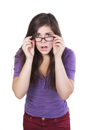 Brunette woman in glasses peering in amazement isolated on white Stock Photo