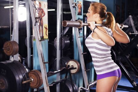 fit woman trains in gym. alone. one. indoors