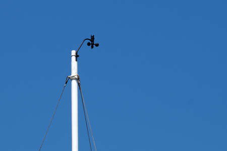 meteorological device for measuring wind speed against a blue sky close-up