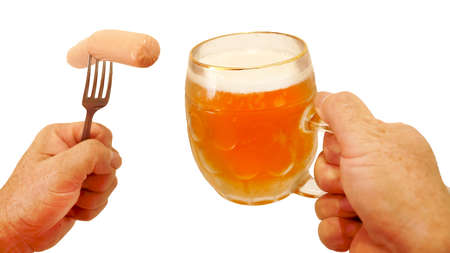 sausage on a fork and a mug of beer in male hands, isolate on a white background