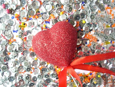 adoration: Shining glass beads, spangles and a heart Stock Photo