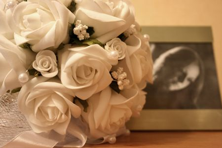 Wedding photo with bunch of flowers and bride's portrait. Still life Stock Photo - 4383830