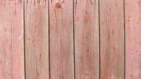 rustic old wood surface made of textured rough planks of pinkish brown color with bunch dots and dry cracks in structure, country style backdrop