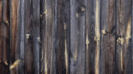 textured wooden background of gray dry planks full frame, rustic style aged wood texture, natural plank backdrop, rural old fence fragment graphic resource
