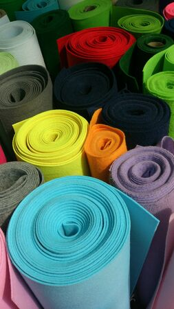 bright: Many colorful bright felt rolls