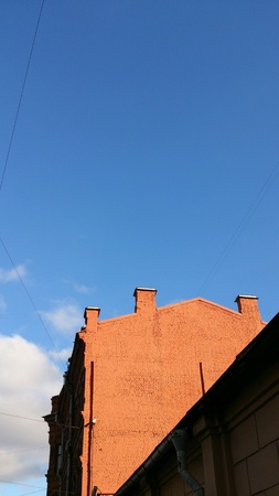 bright: Brick building with bright blue sky