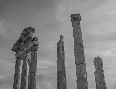 flute structure: Monochrome picture of corinthian columns and fluted capitals with acanthus leaves of the Ancient Greek Temple of Trajan in Pergamon in the territory of the modern city of Bergama in Turkey Stock Photo