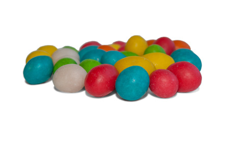 dragee: Dragee peanuts in colored icing isolated with shadows on white background