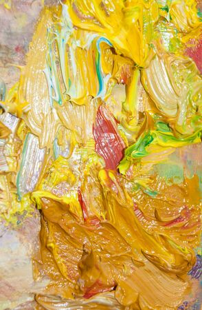 paints: Palette with yellow oil paints close-up Stock Photo