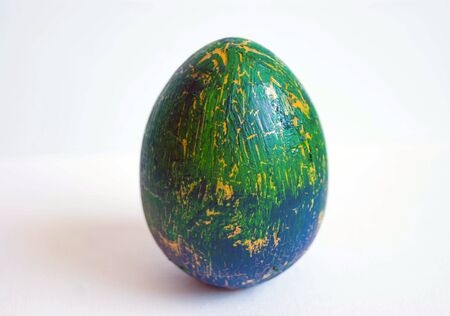 crackles: blue and green Easter egg decorated cracelures with shadow on white background