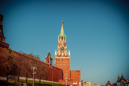 spasskaya: Kremlin Spasskaya tower on Red Square in Moscow, Russia in sunny summer day, toned image with vignette