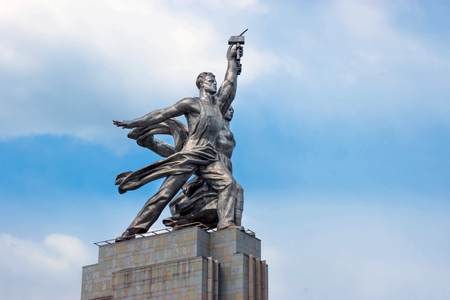 sickle: The monument The Worker and the Collective Farm Woman at VDNH in Moscow, Russia with blue sky and clouds