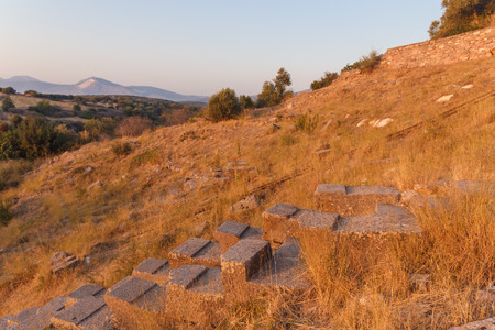 ruins of ancient amphitheatre in Erytrai, Ildiri, Cesme, Turkey sunset time view Editorial