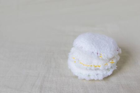 Reusable cotton discs set for face or makeup removal flat lay. Eco-friendly lifestyle, zero waste concept.