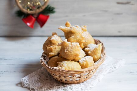 Pettole is a traditional christmas south italian food cooked from dough and fried in olive oil, made in Salento, Apulia Stock Photo