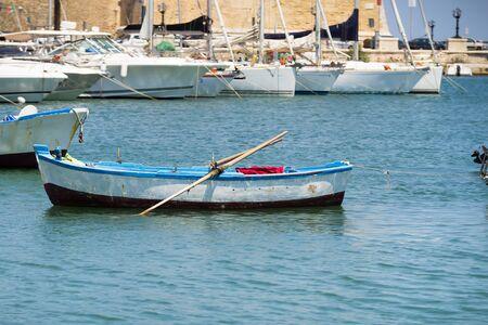 One little boat in the port of Bari, capital of region of Apulia, Italy Zdjęcie Seryjne