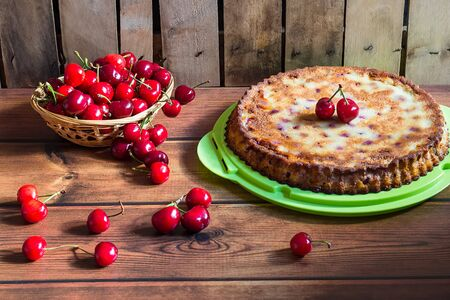 Home made cherry cake with vanilla and black cherries on wooden table Фото со стока