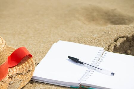 Creativity on vacation at sea, creative writing, looking for inspiration on the beach, clean notepad for text