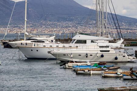 several boats and yachts in the port of Naples