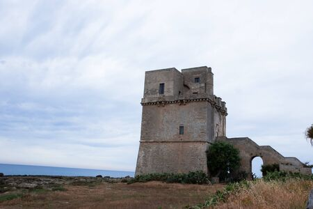 Torre Colimena in cloudy weather, a village on the Ionian Sea in the region of Apulia, watchtower of Salento