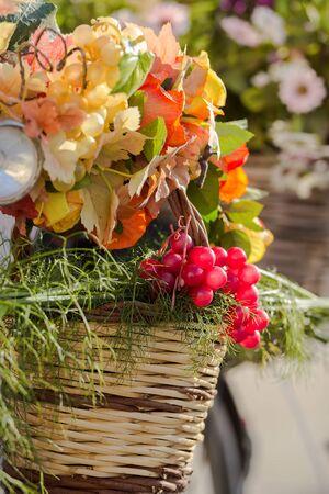 autumn bouquet, basket on bike closeup, vertical