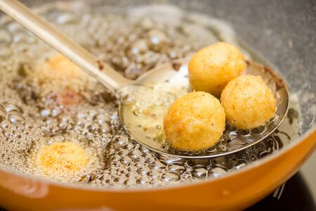 preparation of meatballs in a frying pan at home