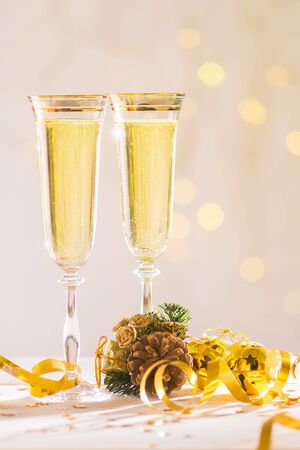 Two glass of Champagne over blur spots light background ready to bring in the New Year, celebration concept, Christmas card, copy space Stock fotó